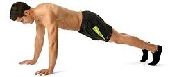 Muž je v pozici prkna a zvedá se hlavně pomocí břišních svalů
